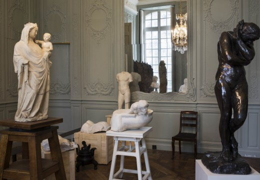 Installation view of a room reconstructed from period photographs of the Hotel Biron, with a 14th-century Virgin and Child (left), Roman torsos on wooden crates, and Rodin's 1881 Eve (right)