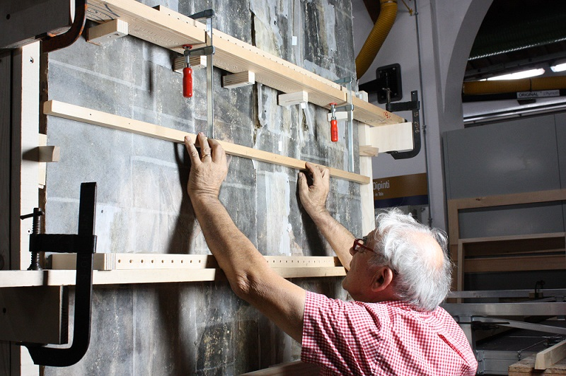Giorgio Vasari's 'The Last Supper' under restoration. Ciro Castelli checking the surface of one of the panels during repair of the board joins. Photo: Britta New