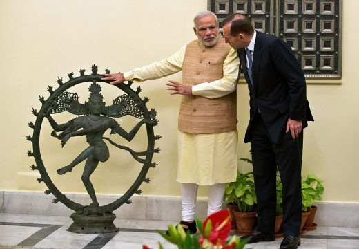 Indian Prime Minister Narendra Modi and Australian Prime Minister Tony Abbott talk alongside a statue of the Dancing Shiva ahead of a meeting in New Delhi, 5 September, 2014. The $5 million bronze statue was returned to India from the National Gallery of Australia after it emerged that it had been stolen from a Tamil Nadu temple. PRAKASH SINGH/AFP/Getty Images)